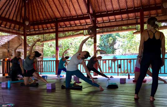 Authentic hands on Yoga class experience